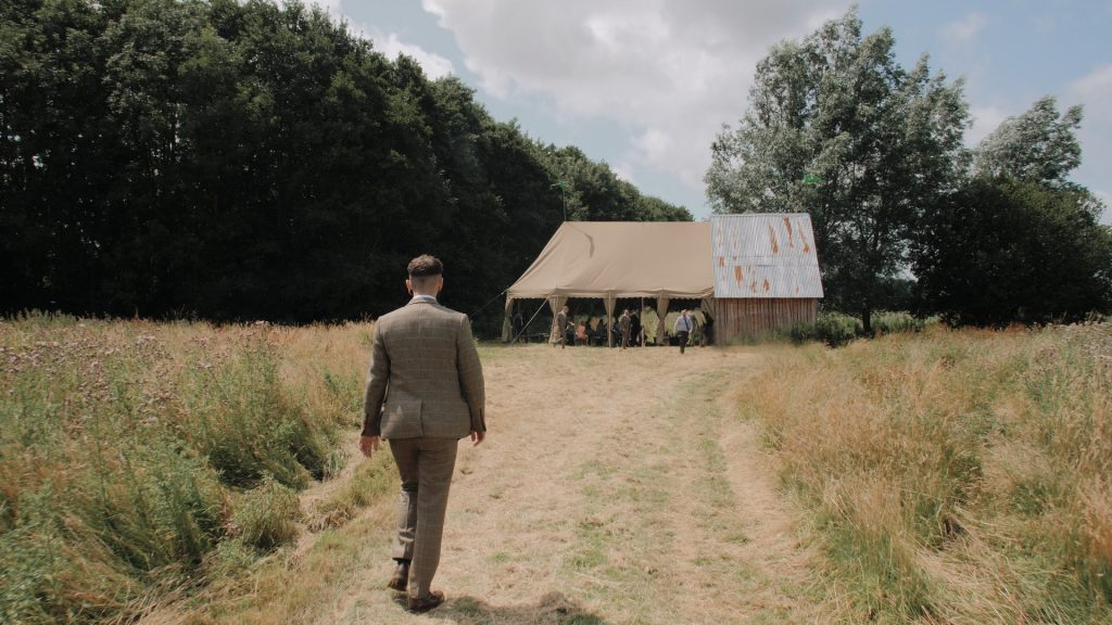 groom walks to ceremony at wilderness wedding venue in Kent