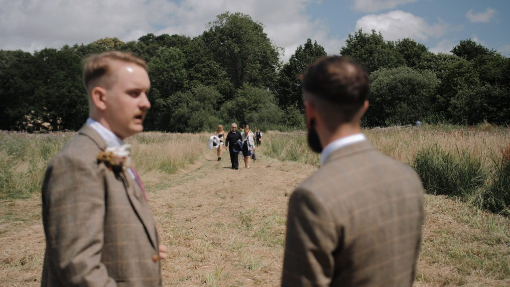 the groom waits for guests at wilderness weddings kent