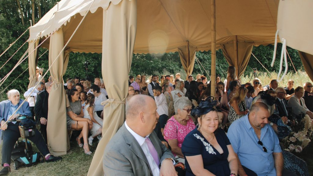 guests wait for the bride to arrive at wilderness wedding venue in kent