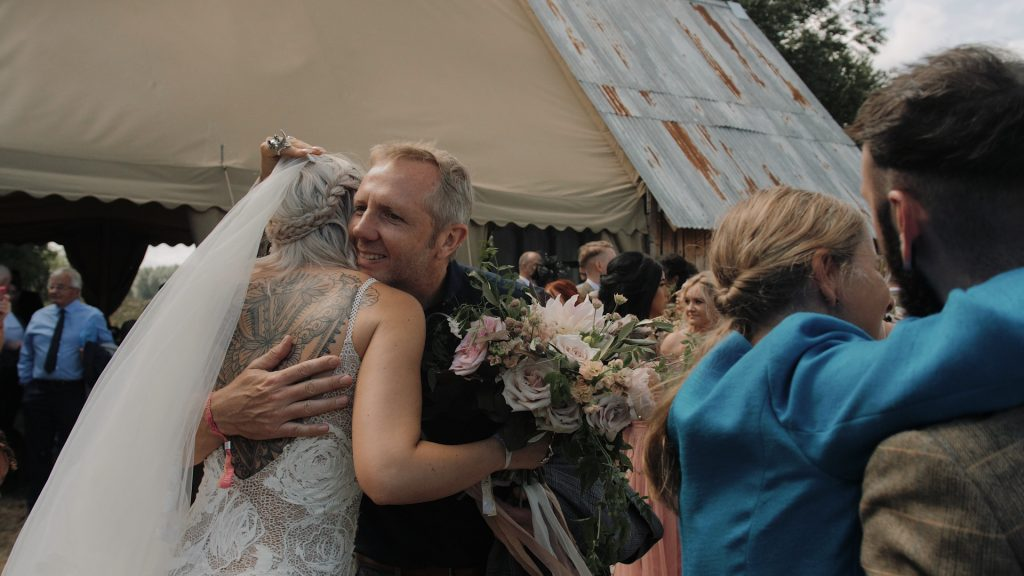 bride is congratulated by a guest at wilderness wedding venue in Kent