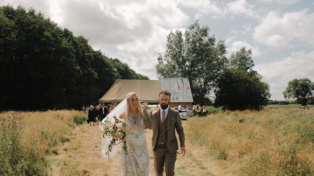 bride and groom walk away from ceremony at wilderness weddings