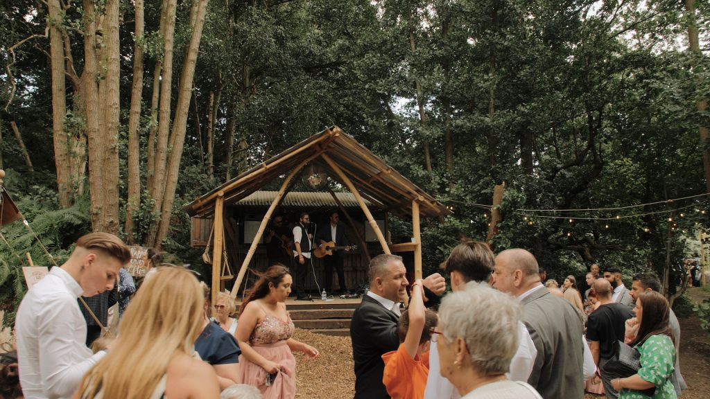 wide shot of band performing at wilderness weddings