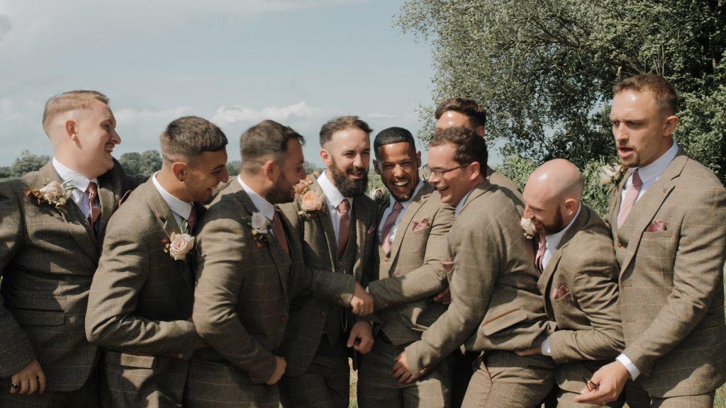 groomsmen have fun at wilderness weddings