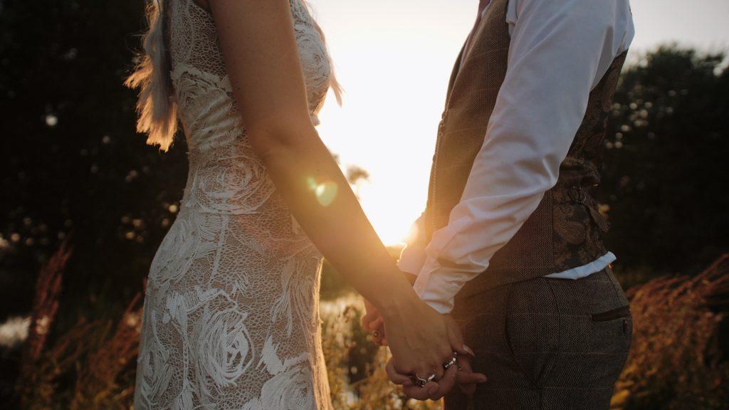bride and groom hands wilderness wedding