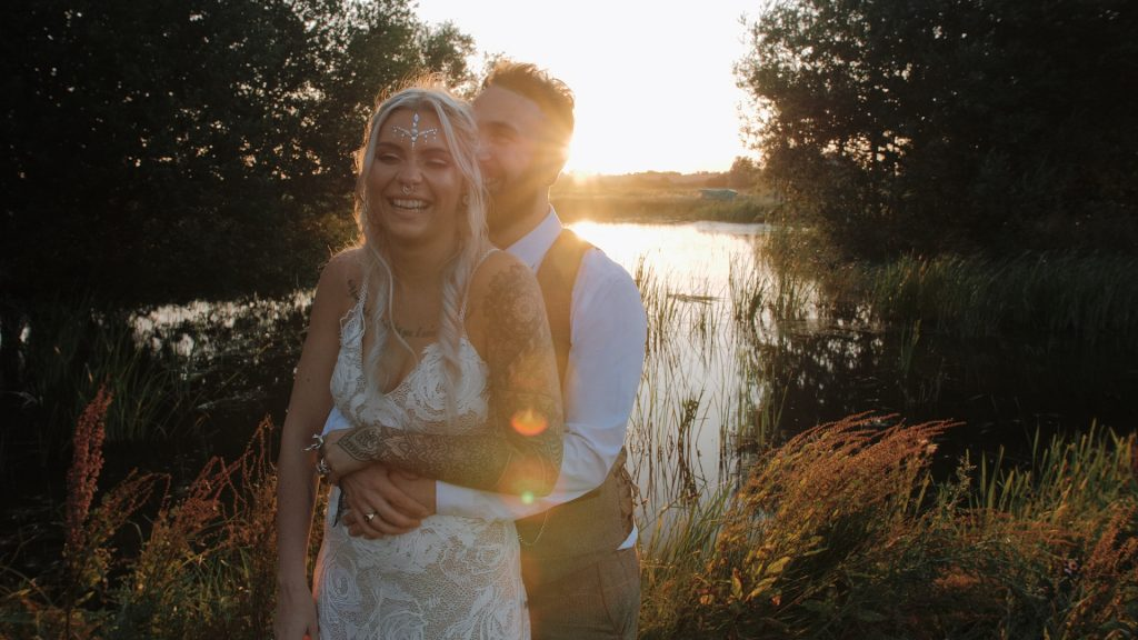 bride and groom laugh at wilderness wedding venue in kent