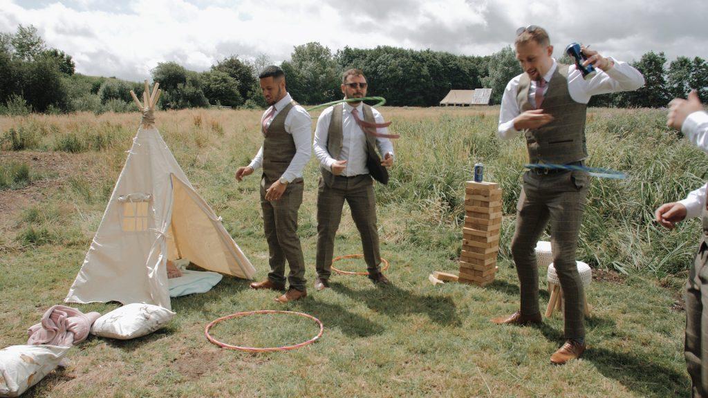 Wilderness weddings Kent groomsmen play